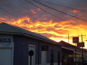 A fiery sky behind Luna Hostel